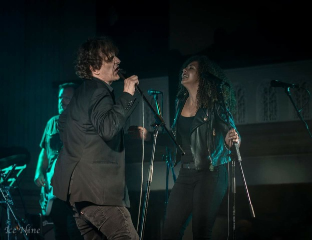dave rave pic of artists singing facing each other