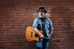 ron whitman pic holding a guitar